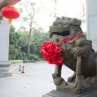 Chinese traditional style stone lion sculpture — Stock Photo #70229327