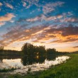 Sunset over an green steppe — Stock Photo #60709853