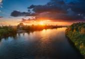 Sunset over river — Stock Photo