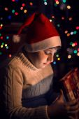 Boy opening Christmas gift — Stock Photo