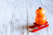 Fruit snowman on a red sled — Stock Photo