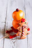 Fruit snowman with Christmas cookies on a red sled — Stock Photo