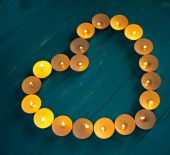 The heart of the candles on a blue background — Stock Photo