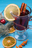 Mulled wine on a blue background — Stock Photo