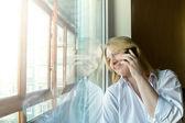 Woman near the window. Sunny morning — Stock Photo