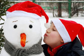 Boy with snowman. — Stock Photo