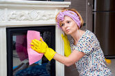 Tired housewife washes fireplace — Stock Photo