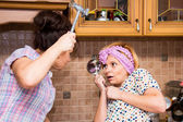 Fight housewives in the kitchen — Stock Photo