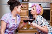 Two tired housewife drinking wine — Stock Photo