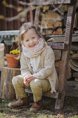 Cute happy child girl having fun in early spring garden — Stock Photo