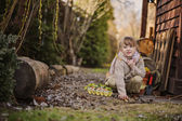 Cute happy child girl sitting with easter egg box with plants in the garden — Stock Photo