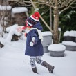 Cute child girl having fun on the walk in winter snowy garden with christmas candy — Stock Photo #62034337