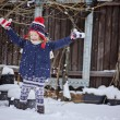 Cute happy child in christmas hat girl throwing snow and having fun in winter snowy garden — Stock Photo #62034359