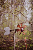 Rustic handmade windmill in early spring garden — Stock Photo