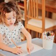 Preschooler child girl drawing with colored pencils at home — Stock Photo #65335961