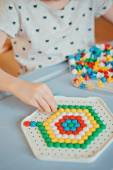 Close up of child hands plays with mosaics at home — Stock Photo