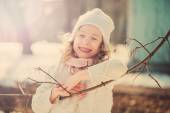 Spring vintage tones portrait of cute happy child girl on the walk in early spring — Stock fotografie