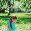 Happy kid girl playing in spring blooming apple garden — Stock Photo #70650801