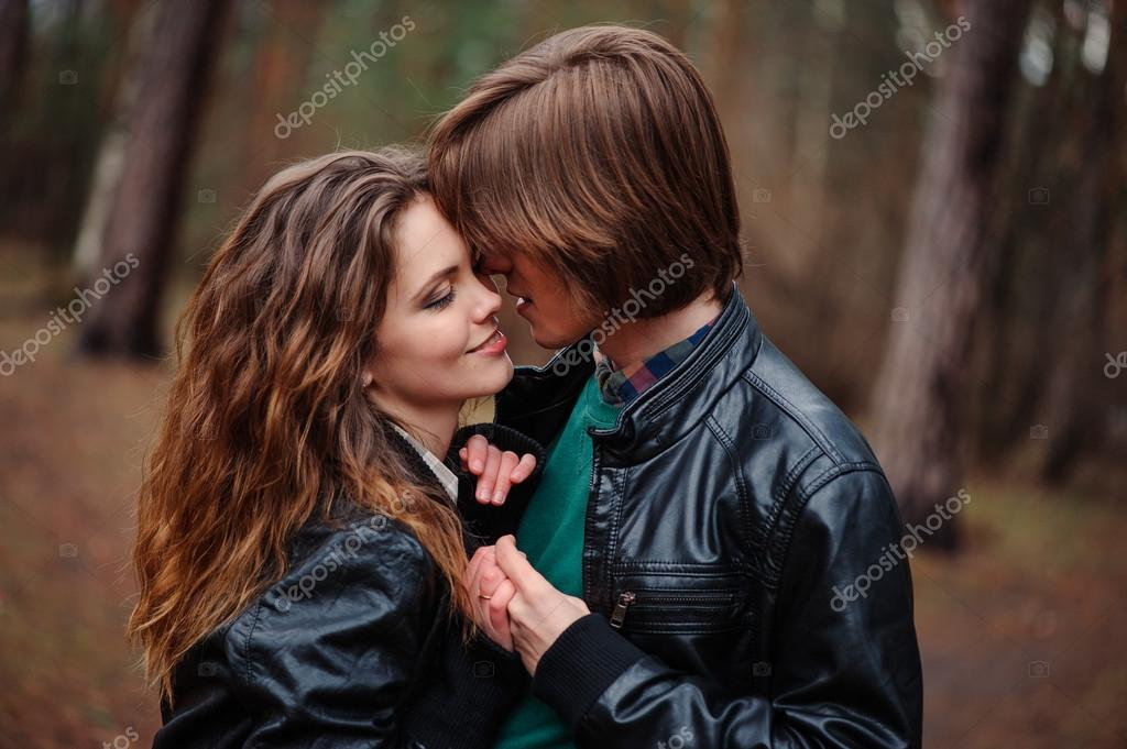 Happy Loving Couple In Leather Jackets Walking Outdoor