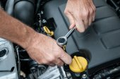 Hands with a wrench that repair a car angine — Stock Photo