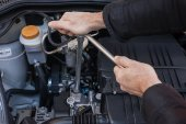 Hands with a wrench that repair a car engine — Stock Photo