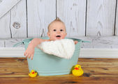 Sweet baby boy playing in washtub — Stock Photo