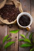 Coffee on a wooden background — Stock Photo