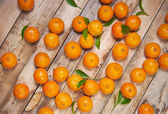 Tangerines on a wooden background — Stock Photo