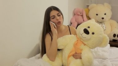 Wicked girl talking on the phone — Stockvideo