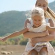 Beautiful young mother in a dress turns little daughter, slowmotion — Stock Video #61023051
