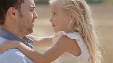 Little girl fooling around on fathers hands — Wideo stockowe