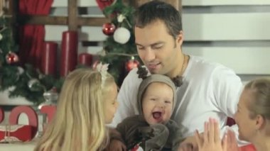 Beautiful happy family with cute baby dressed as a deer enjoyed — ストックビデオ