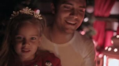 Close up of a wonderful family celebrating the New Year with sparklers and smiles — Stock Video