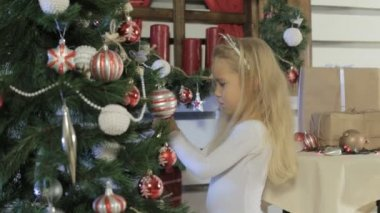 Cute little girl decorates the Christmas tree — Stock Video