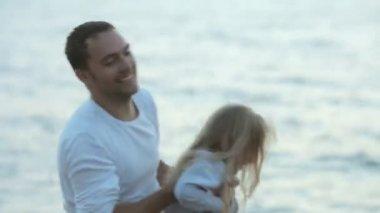 Happy family at the seashore — Stockvideo