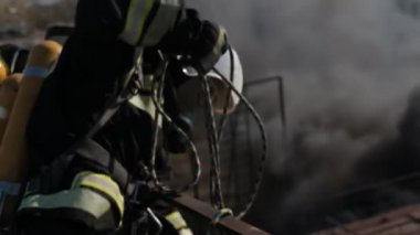 Firefighters in a gas mask doing their job standing high — Stock Video
