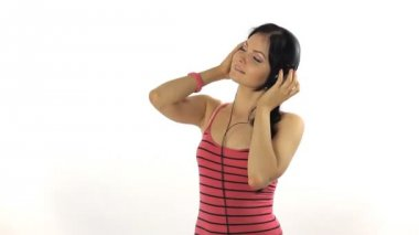 Music Woman dancing with  headphones listening to music on mp3 player — Stock Video