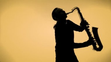 Young man playing sax in the dark — Stock Video