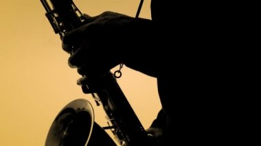 Man playing sax in silhouette. Close-up — Stock Video
