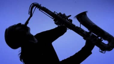 Young man playing sax in the dark. Close-up — Stock Video