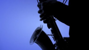 Saxophone player in a color background. Close-up — Stock Video