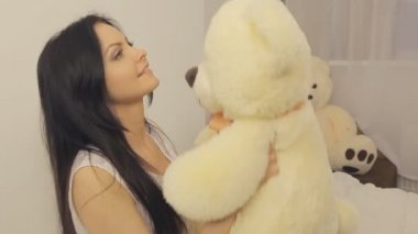 Girl plays with teddy-bear — Stock Video