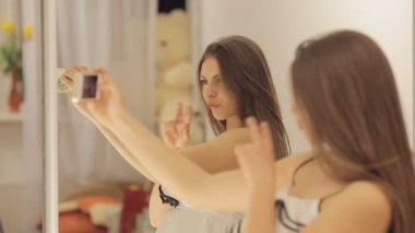 Girl dances and takes photo of herself — Stock Video