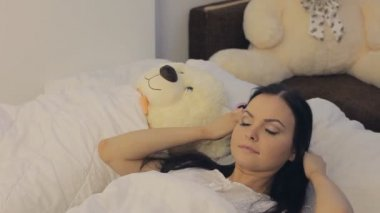 Young woman awakes — Stock Video