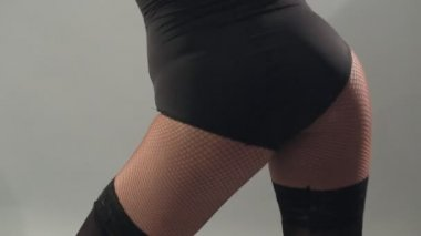 Close-up of dancing girl in stockings, lower body — Stock Video