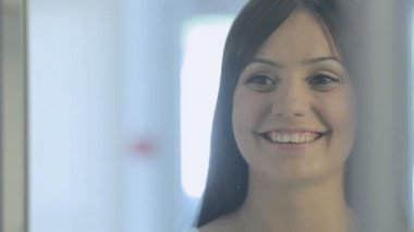 Young brown-haired woman in a drugstore — Vídeo de Stock