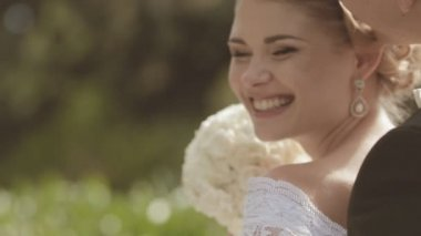 Close-up of groom and laughing charming bride — Stock Video