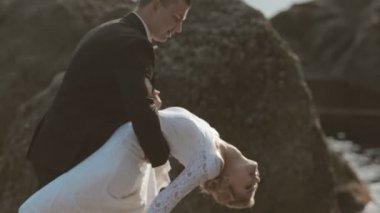Close up of newlyweds dancing on the seaside near cliffs — Stock Video