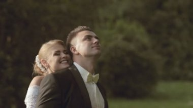 Happy and enamored bride and a groom — Stock Video