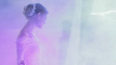 Bride and groom dancing their first wedding dance in a smoke — Stock Video
